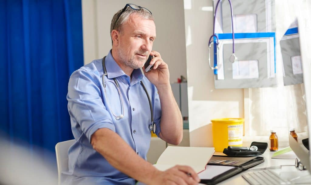 Photo of vet on the phone speaking with a veterinary sales rep
