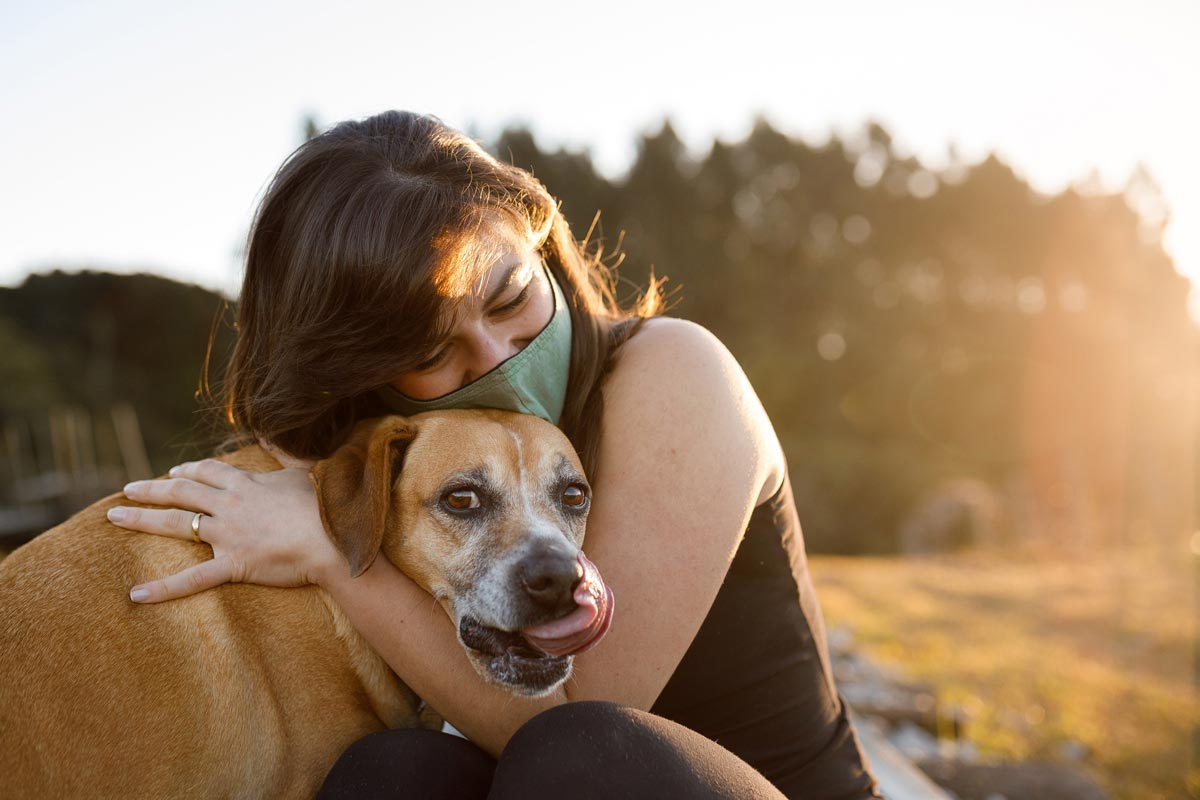 Photo of dog and its pet parent representative of MWI Animal Health.