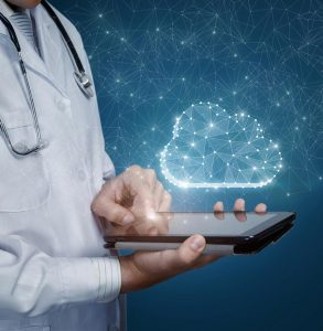 Photo of vet using a tablet with the cloud representative of veterinary technology.