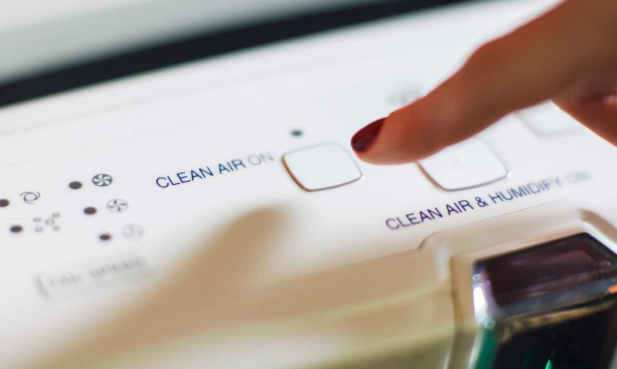 Photo of finger selecting clean air button representative of air filtration.