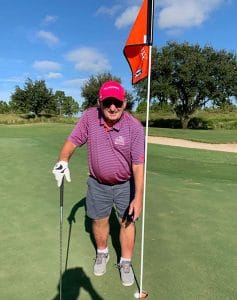 Paul Brennan on green after hole in one.