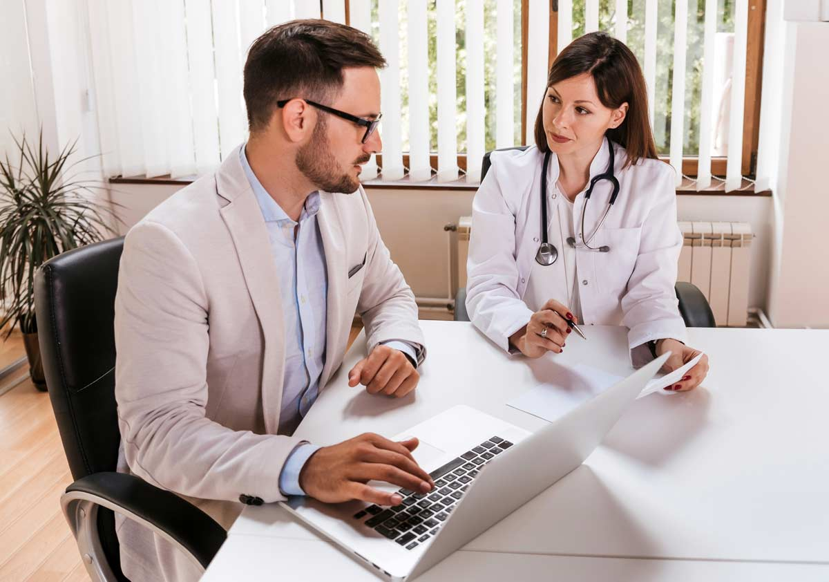Photo of entrepreneur speaking with a veterinary professional.